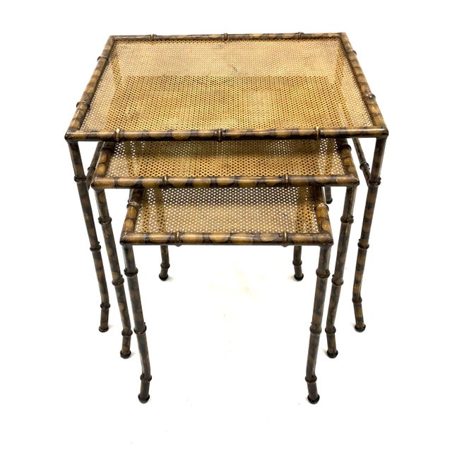 A very unique and hard to find set of faux bamboo nesting tables. These are entirely made of metal. The bamboo paint...