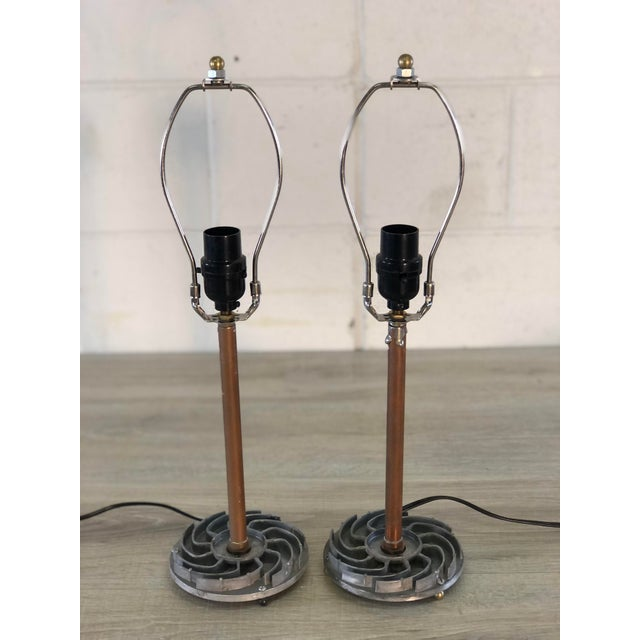 Pair of table lamps designed with recycled car parts and copper piping. Wired for the US and in working condition. The car...