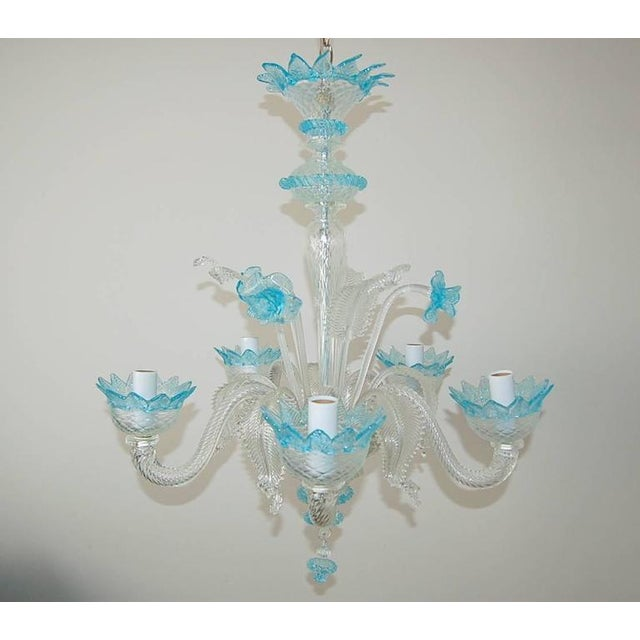 Very chic vintage Venetian five-light Murano glass chandelier made of CLEAR Murano crystal with BLUE glass accents. Newly...