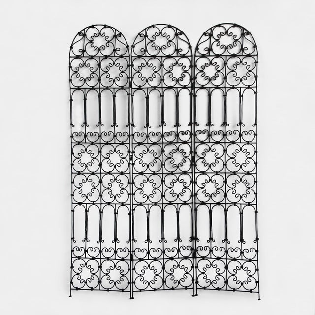 Folding three panel black iron screen with Moorish decorative pattern. Great for use indoors or out.