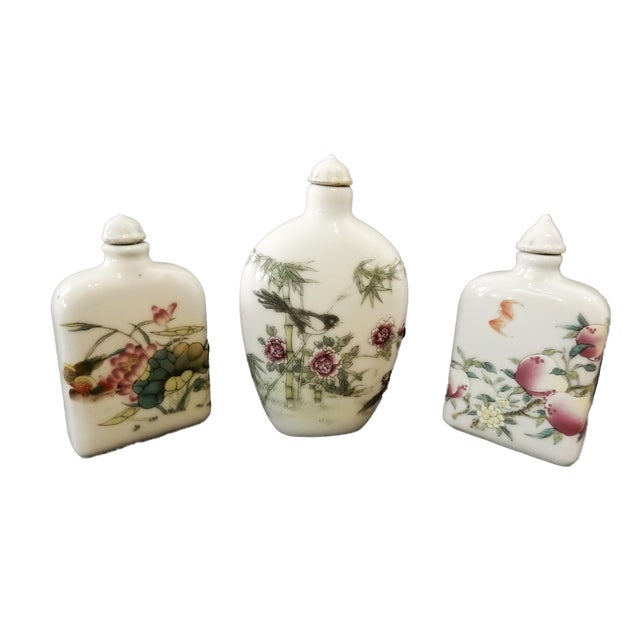 Superb set of three lidded Famille Rose Snuff bottles decorated with peaches ,bird, bamboo,lotus flower etc... for good...