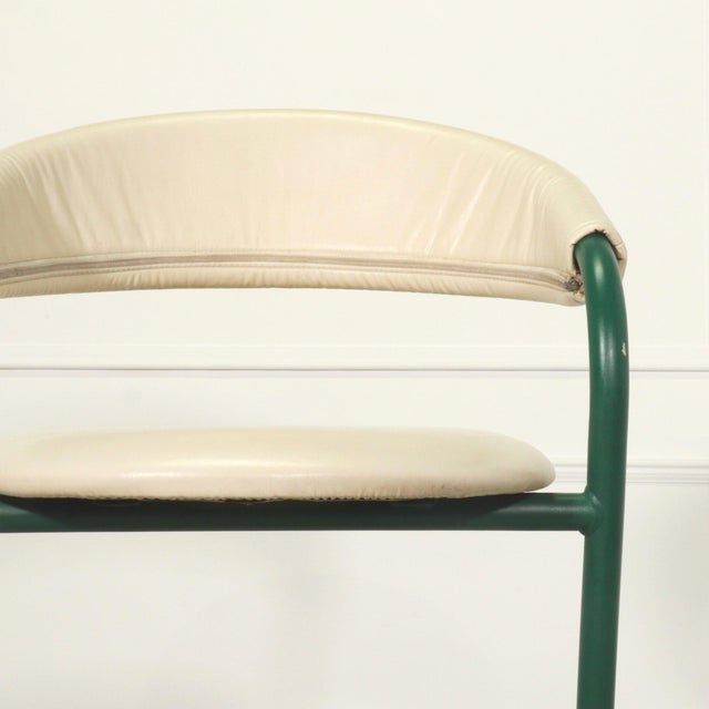A wonderful pair of Amisco cantilevered bar stools in original green finish and leather upholstery with zippers.