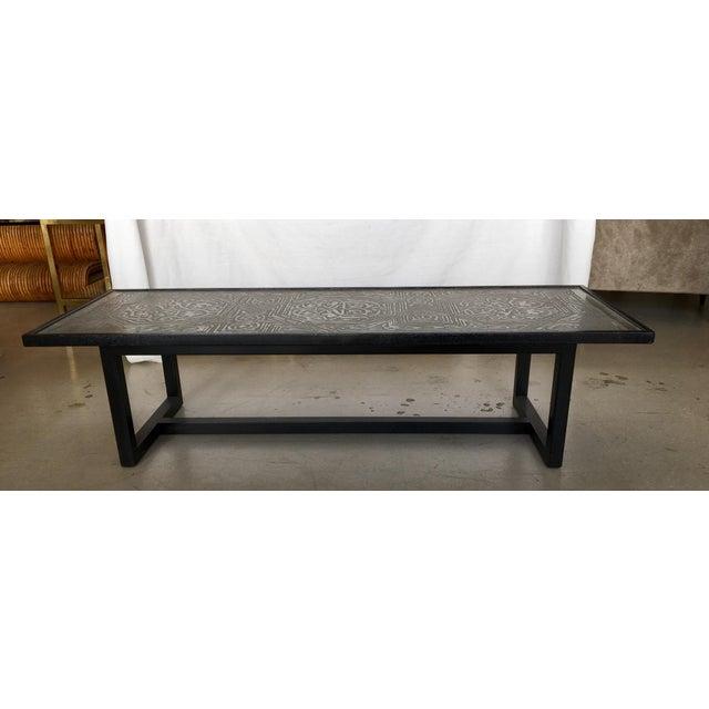 European rectangular acid etched metal coffee table with ebonized black legs.