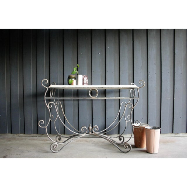 """Fanciful, perfectly aged French iron butcher / pastry table. Perfect for a greenhouse, conservatory or sunroom. 49.75""""W x..."""