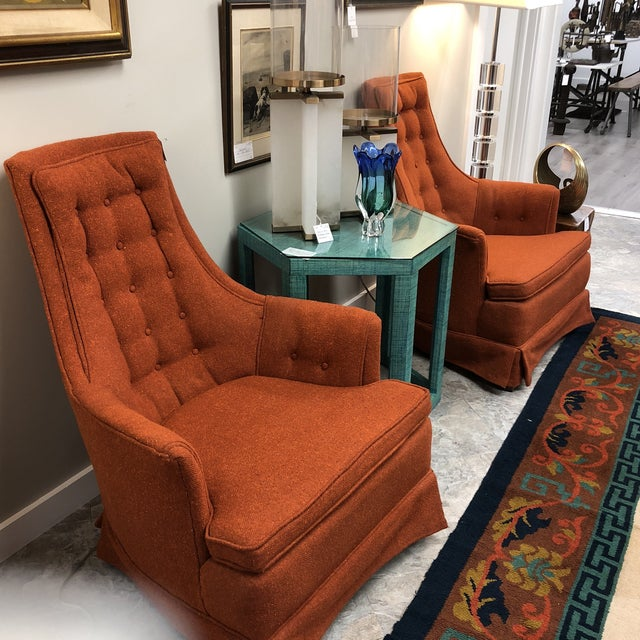 Highly stylized midcentury modern club chairs