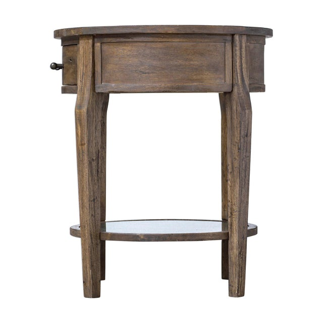 THis sweet wooden table is so functional with both a drawer and a shelf. Made to look rustic yet has a refined inference...