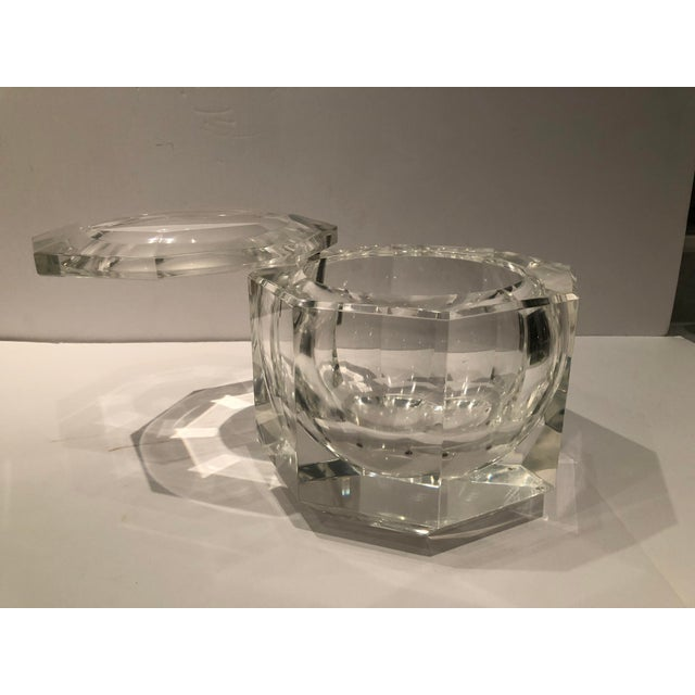 Italian Modern pivoting and faceted ice bucket in lucite by designer Alessandro Albrizzi. Ice bucket has a rounded form...