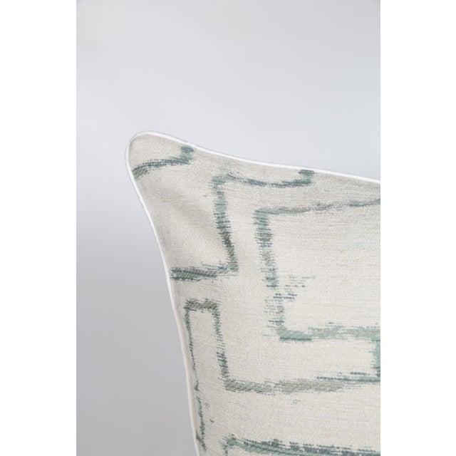 Pair of ivory, sea foam green/blue pillows with a slight metallic thread tribal geometric print and ivory silk cording....