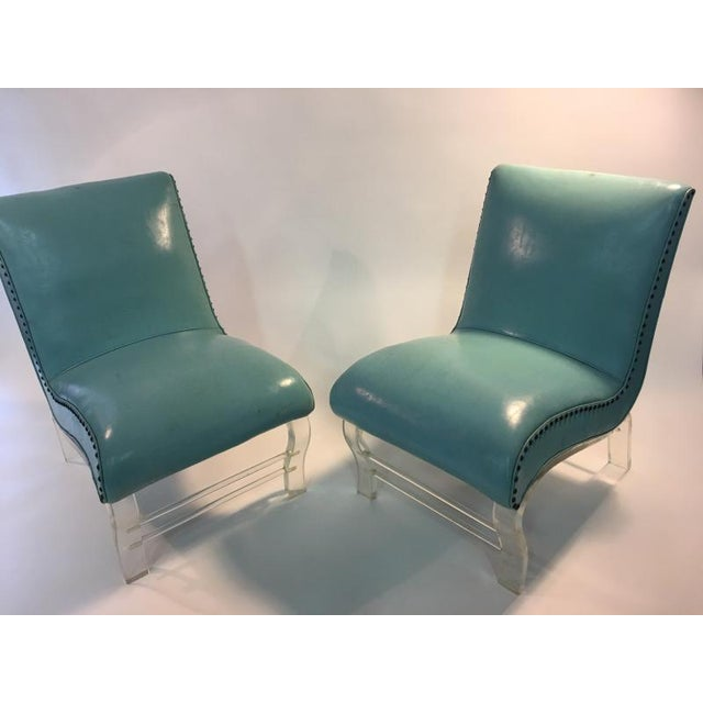 Glamorous Pair of Undulating Design Lounge Chairs with Graceful Lucite Feet and Stretchers. Upholstered in Original Aqua...