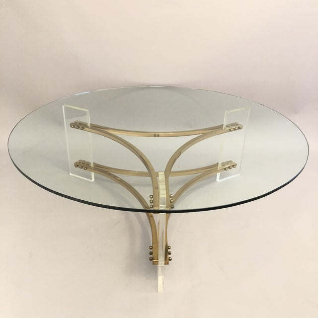 Charles Hollis Jones Brass, Glass, and Lucite Coffee Table, 1970s. Round Glass top fits on base and is removable for easy...