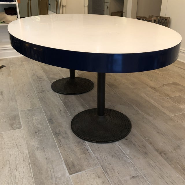 ICF Made in Finland oval white & blue table with metal base. The legs show rust. The white top is Formica. The side navy...