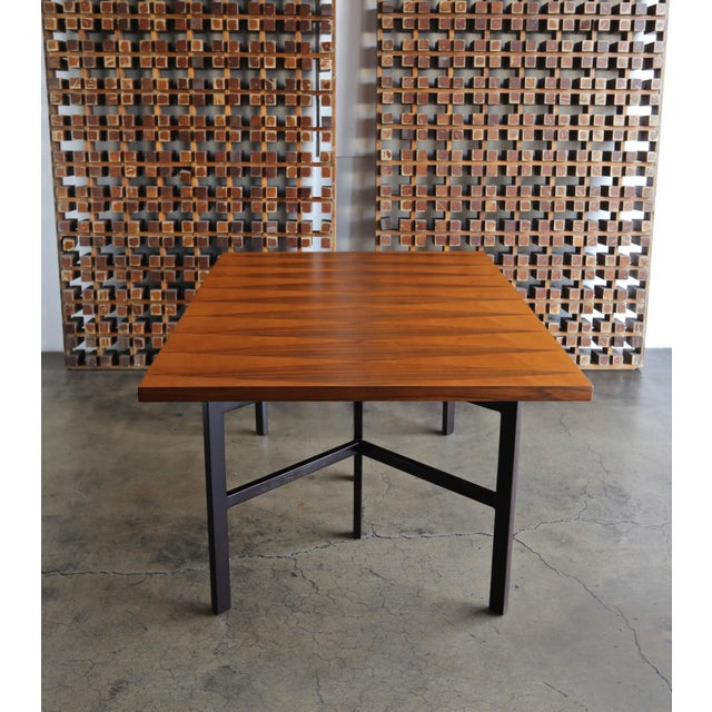 Milo Baughman dining table for Directional Furniture circa 1960. Diamond shaped walnut and teak inlay to the top. This...