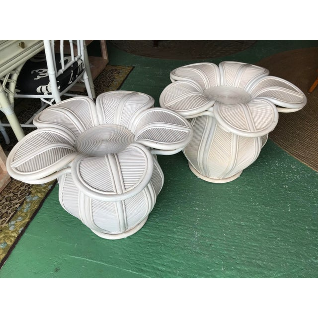 Tropical pair of pencil Rattan Bell flower side tables in as found condition. Great tables with minor flaws but would look...