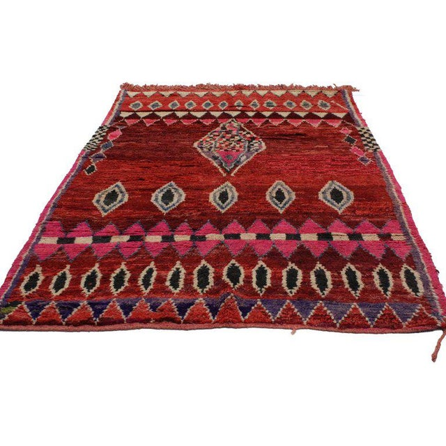 20284, vintage Berber Moroccan rug with tribal style. This hand-knotted wool vintage Berber red Moroccan rug features a...