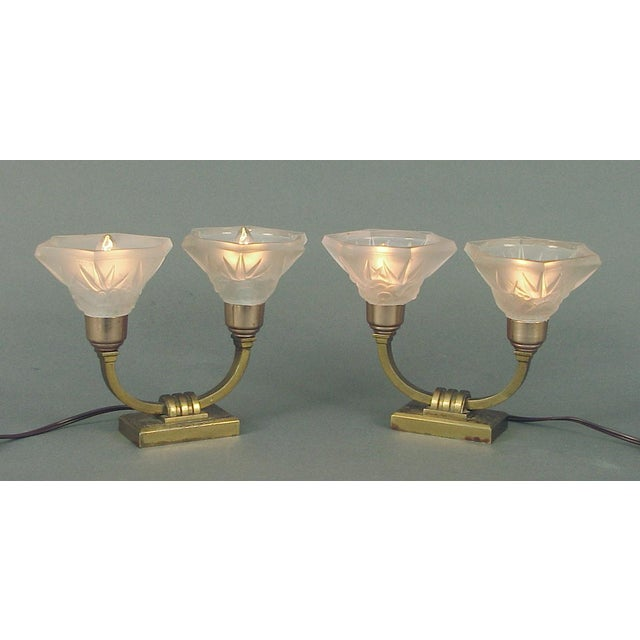 Lorrain (the shade manufacturer) was one of France's premier glass fabricators for lighting. The bases, as you can see,...