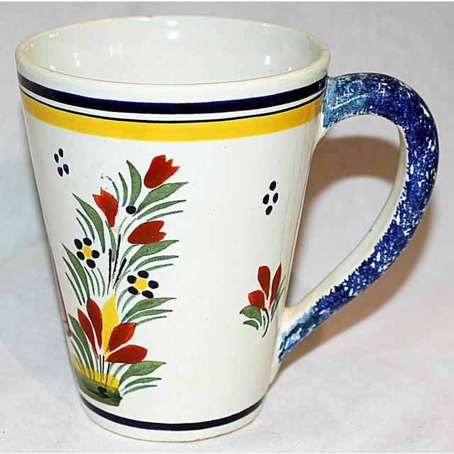 Henriot Quimper tea or coffee conical-shaped mug in classic Quimper motif. Mark dates circa 1920-1930s. Some slight age...