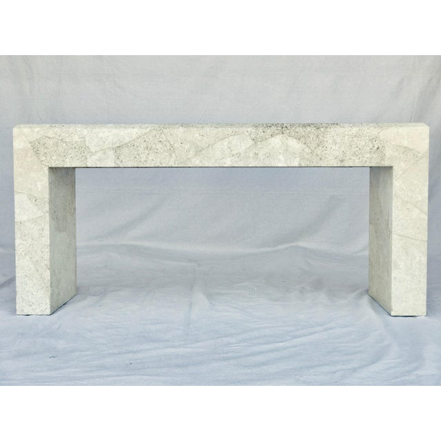 An impressive console table in the manner of Karl Springer. Asymmetrical hand crafted parchment sheets layer across the...