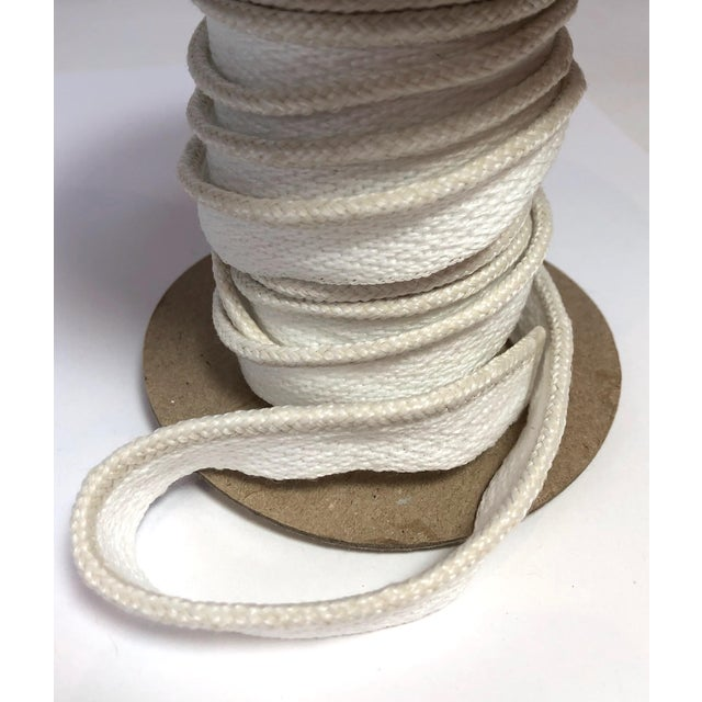 """One, 10 yard spool of 1/8"""" braided cord with flange. Flange is 1/2"""" wide for sewing. Cording colors: cream/white blend..."""
