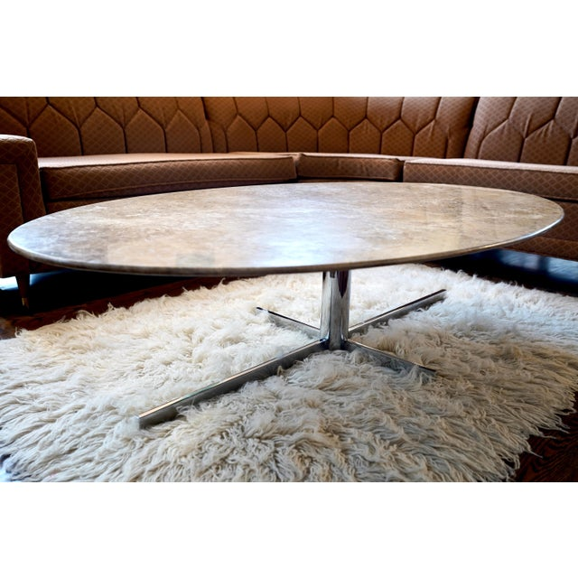 Mid century Knoll style marble table with heavy chrome base. Top has wear consistent with age. A few rubs and marks. A...