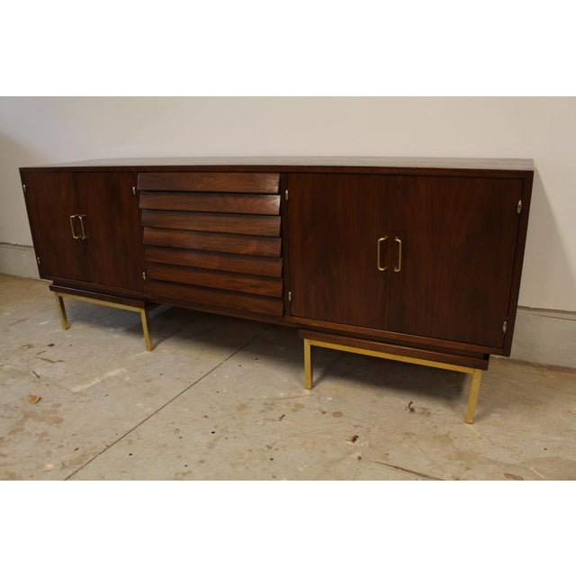 Professionally refinished Walnut Credenza in the Dania Line designed by Merton Gershun from American of Martinsville. It...