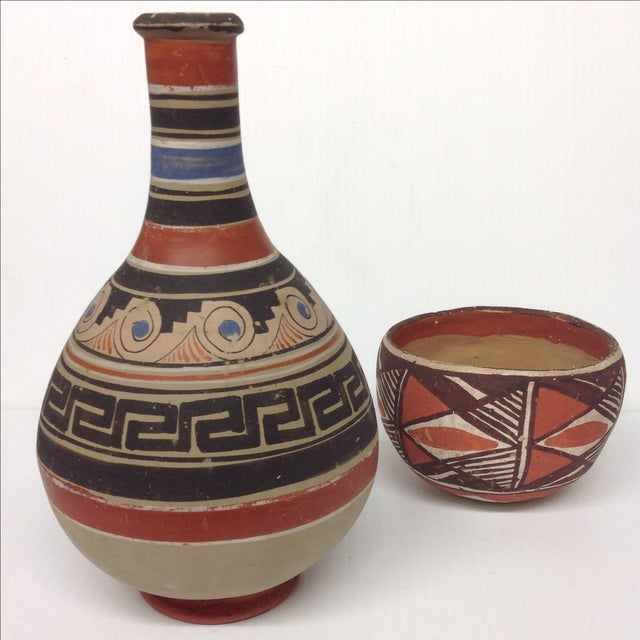 Mid-century Native American pottery collection. Blue, orange, black, and brown. Price is for both pieces.
