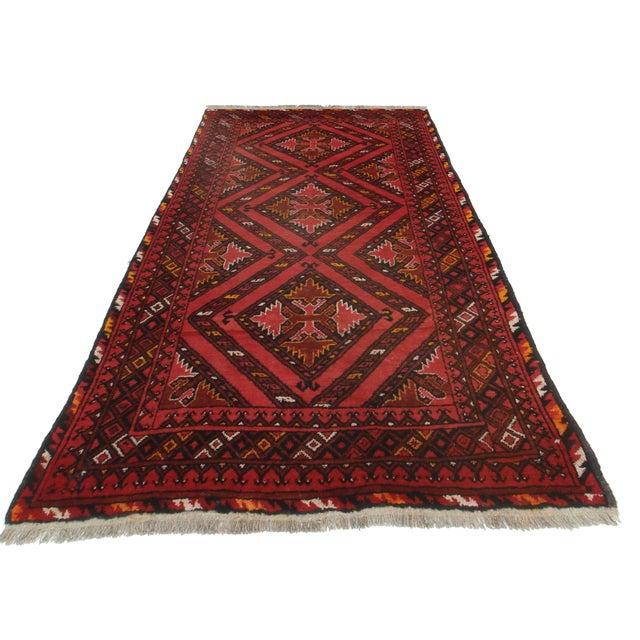 Hand Knotted Wool Afghan Turkman Rug. Geometric design. Measures 4′1″ × 6′5″.
