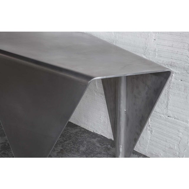 A client wanted us to create a desk based on the Mantis, so we scaled it up for them. Made out of solid aluminum, we gotta...