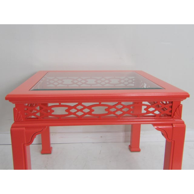 Large carved wood coffee table with glass top in a new lacquer finish. The new finish is coral ( paint color is called...