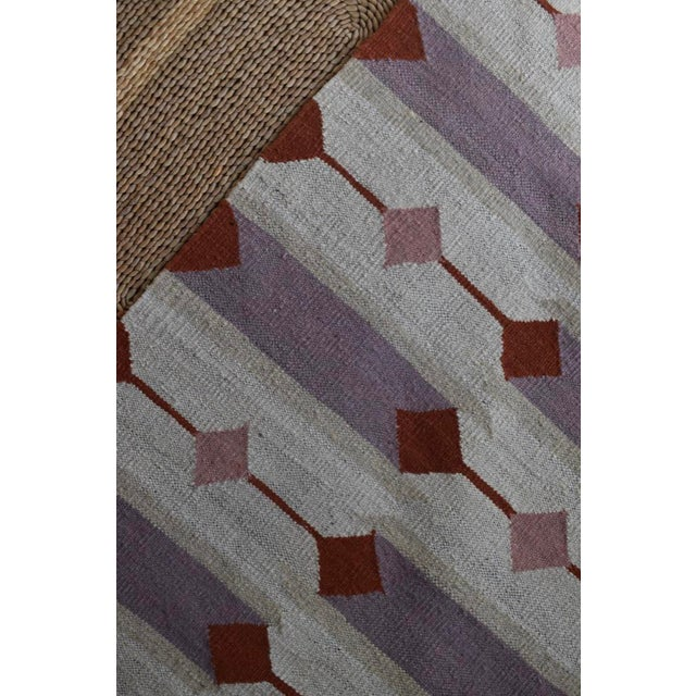 Inspired by the natural clay formations present in Northern Afghanistan, this terracotta colored rug is a must have for...