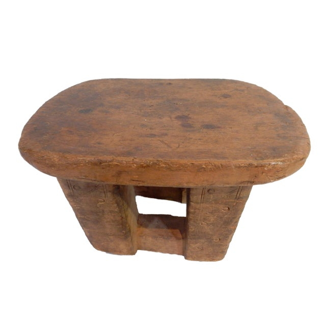 Superb Old Bamelike low milk stool from Cameroon. Hand-carved from one piece of wood with two heavy legs and an abstract...