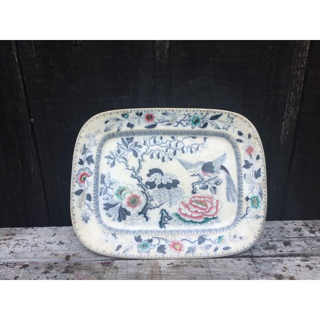 We are in love with this platter! It has a beautiful muted blue floral and bird motif with pink and green accented...