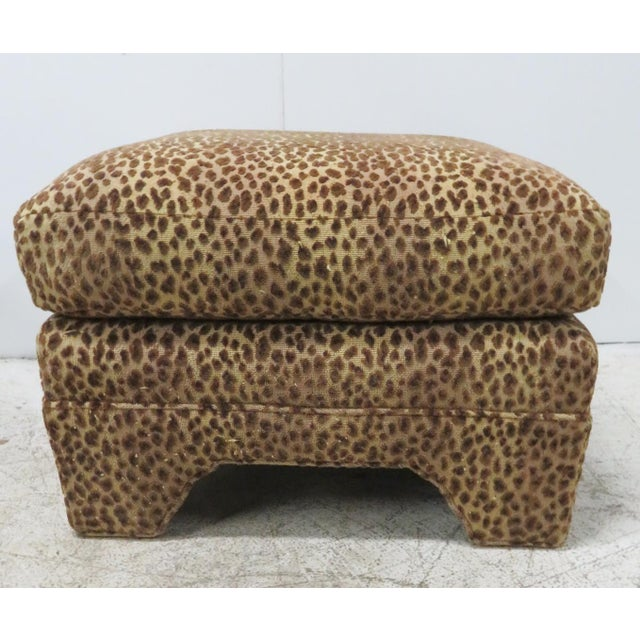 Leopard print pillow top form ottomans with Chippendale style bracket cut out feet.