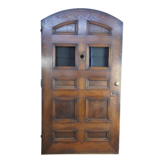 Early 20th Century Spanish Solid Oak Reclaimed Arched Panel Door For Sale