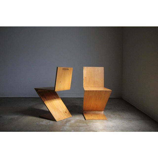 Vintage pair of studio made Zig Zag chairs in the manner of Gerrit Rietveld, circa 1970s. Constructed of lovely figured...