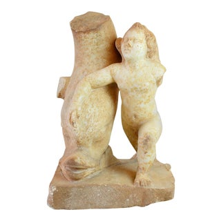 Sculpture of Cupid With a Dolphin For Sale