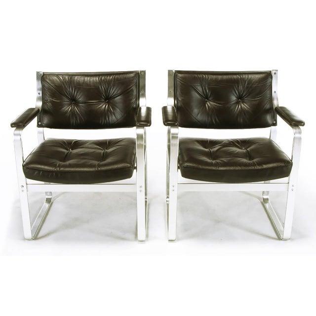 Pair of Mondo armchairs designed by Karl-Erik Ekselius, (1914-1998) for J.O. Carlsson Mobler Vetlanda, Sweden. Polished...
