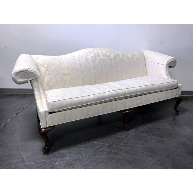 Here is a very nice sofa by quality furniture make Drexel. Ivory upholstery with pale blue stripes, on a wooden frame with...