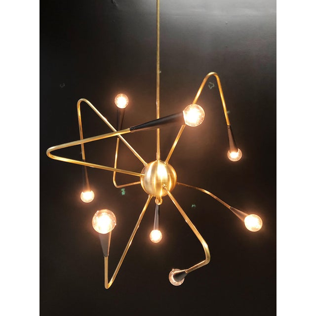 Up for grabs is this magnificent newly fabricated Sputnik style chandelier that's made locally in Los Angeles. This...
