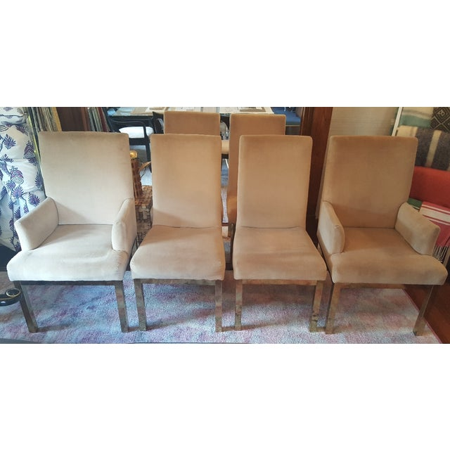 Set of 6 Milo Baughman dining chairs in a pink/ mauve upholstery with brass legs. 2 arm chairs: 24x23.5x41 4 side chairs:...