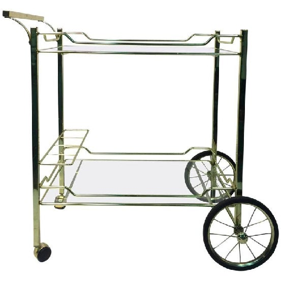 A beautiful brass and glass vintage bar or tea cart made for the Design Institute of America (DIA), circa 1970.