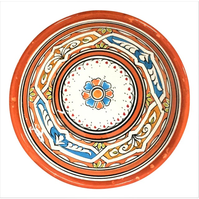 With a wonderfully intricate and inviting regional design pattern, this handcrafted Berber-style triangular orange ceramic...