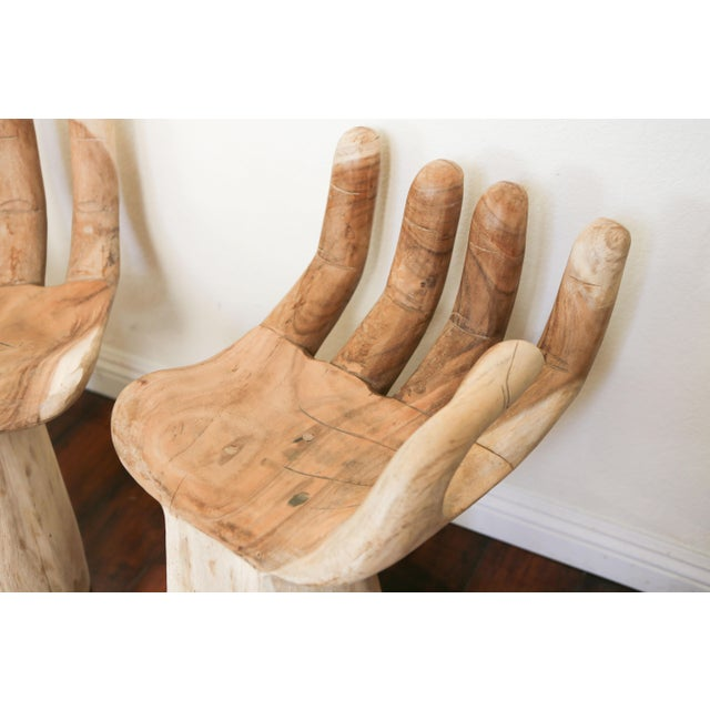 A cool and unique piece in the shape of one of a kind hand chairs. More like art but surprisingly comfortable to sit in,...