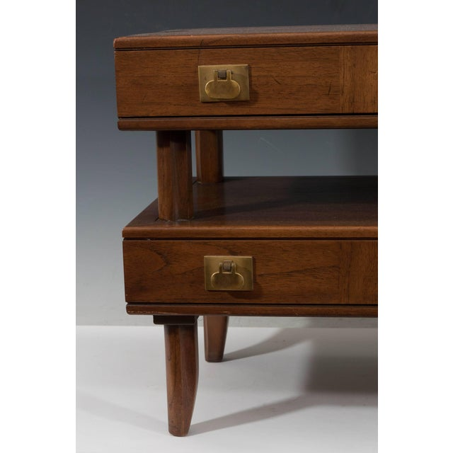 A vintage small chest of drawers in wood, produced by Mastercraft circa 1970s, the drawers separated into two tiers, with...