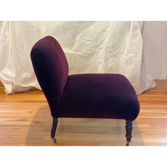 Lovingly restored in early 2000's, a pair of deep red, almost purple velvet slipper chairs. Turned front legs with brass...