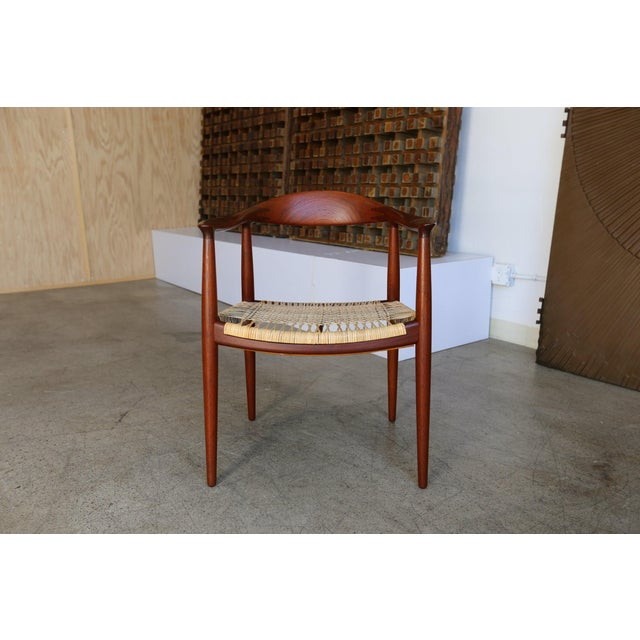 Round chair in teak with cane by Hans Wegner for Johannes Hansen. Made in the mid 20th century in the style of mid century...