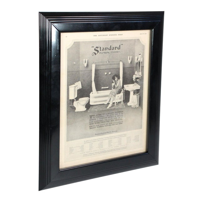 "A framed advertisement for Standard Plumbing Fixtures from the ""Saturday Evening Post"" dated April 30, 1921 featuring a..."