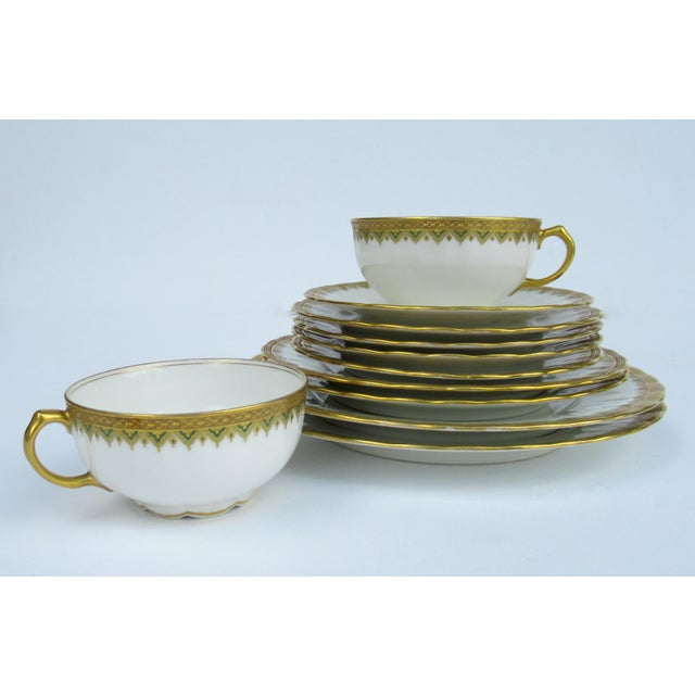 C.1930s; French Limoges 24k Gilt with green rimmed design pattern, assorted set of dishes by Elite S & M Porcelain...