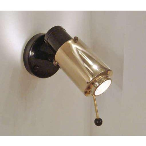 Pair of brass and enameled metal sconces by Lita, adjustable by lever, magnifying lens
