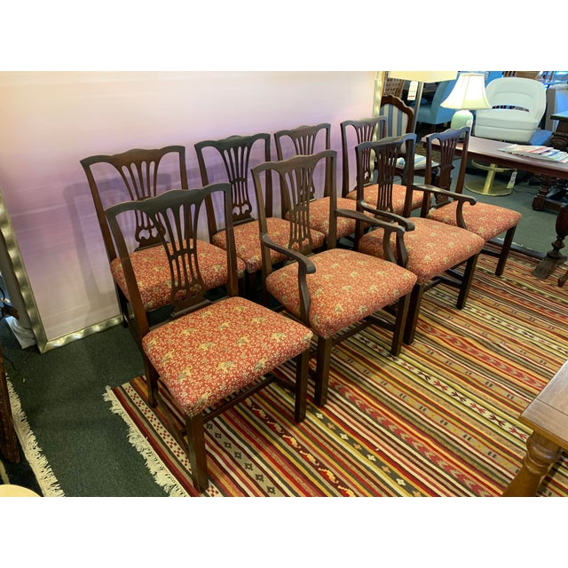 Design Plus Gallery presents a Set of 8 Chippendale Chairs. The classic styling includes scalloped back with swooping...