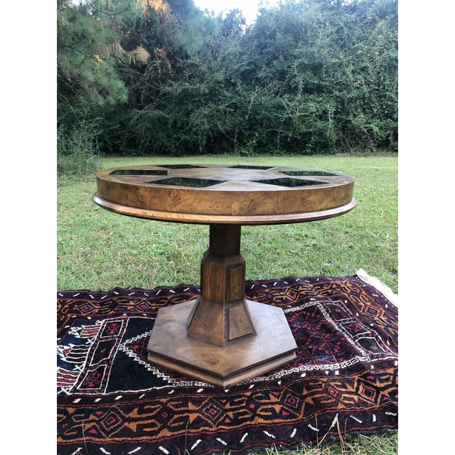 Amazing mid century piece. Burlwood design with smoked Inset removable glass Perfect table to place between two of your...